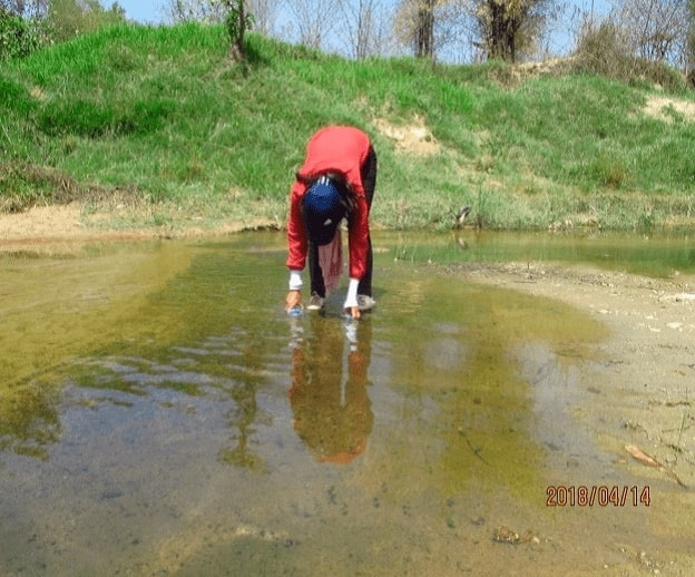 collecting water sample- geological tour